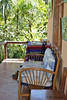 Birdwatcher's House covered terrace. Hammock, couch, table with bird books, a couple chairs.