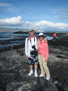 On Fernandina Island with our ship in the distance (and some marine iguanas in the background just behind us).