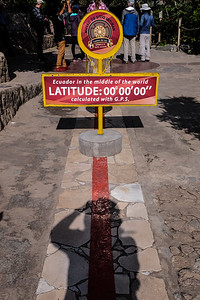 Straddling the equator.