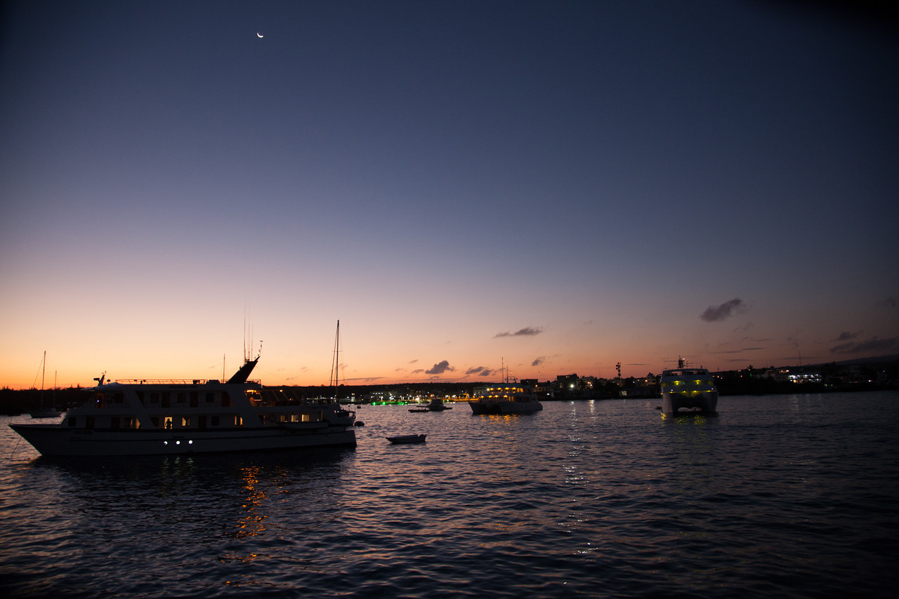 Sunset view from the stern of Queen of Galapagos overlooking the other boats at anchor.