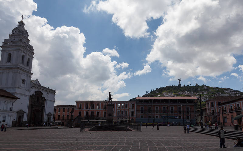Plaza Santo Domingo right next to a very busy bus stop. A good view of El Panecillo up on the hill.