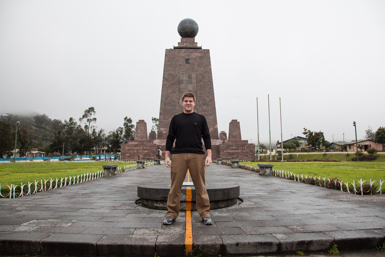 """Straddling the equator at Mitad del Mundo. See the Wikipedia article for a discussion about whether this is the """"true"""" equator."""