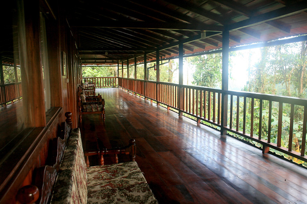 Rooms line this open deck