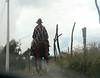 Ecuadorian cowboy trotting off.