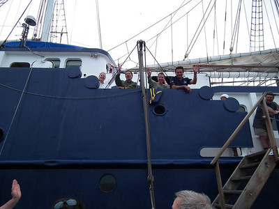 Capt. Omar and others waving as we left for the last time