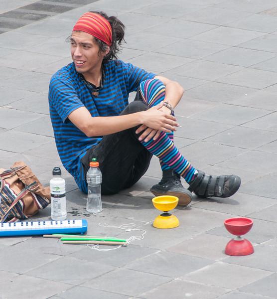 • Location - Quito, Ecuador<br /> • A man taking it easy between his street performances