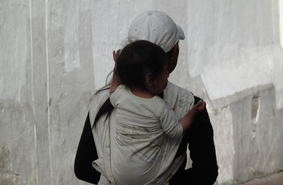 Mothers always carry their babies on their back. Often they wear baseball caps.
