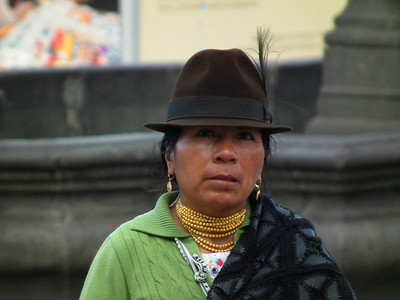Most of the indigenous women wear round hats.