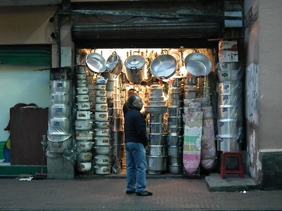 Every day this tiny pot shop is opened up by moving and hanging all the pots away from the 2 foot wide isle.