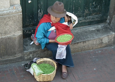 Pea seller with her baby.
