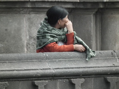 A woman looking on to the Plaza Grande.