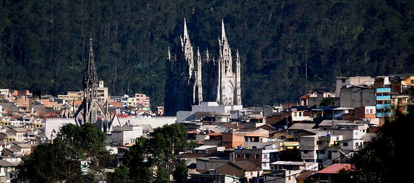 Thanks to the Taxi driver, he pulled to the side of the road after coming back from the Equator.  The tall steeple to the left is at the back of the Basilica.
