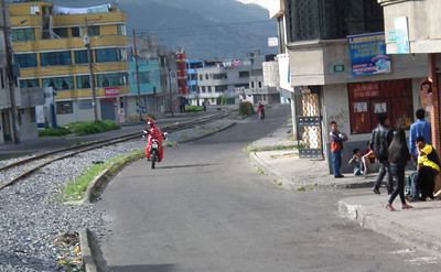 The motorcycle rider as we come into Quito. He is speeding ahead in order to stop traffic at the next intersection. Truly an escort.