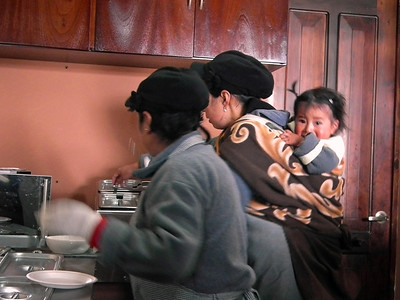 Inside the Boliche station, one of the cooks always had her baby on her back.