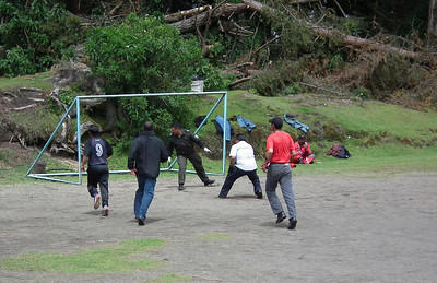 Some of the train workers and their soccer game. The man on the far right sitting down was one of the motorcycle escorts for the train.
