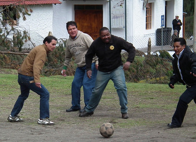 After the train reached Boliche, all of the men who ran the train have a routine of playing a game of soccer. The man in the middle with the orange circle on his sweater was the breakman for the train. He is in the next photo operating a wheel that does something under the car.