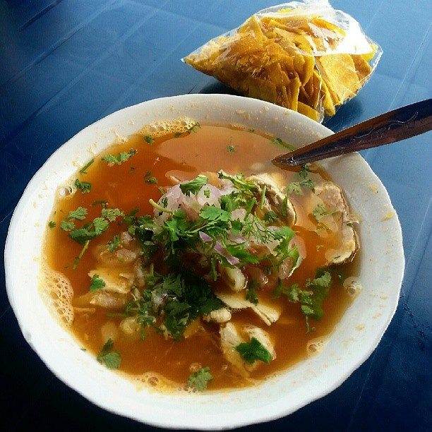 Encebollado is an Ecuadorian fish and onion soup that is usually eaten for breakfast and is a sure-fire hangover cure. Here's the ultimate list of what food to eat in Ecuador.