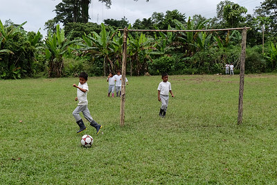 Playing football. Visiting with the children at a Kichwa school - Ecuadorian Rainforest.