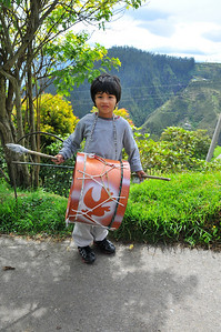 Boy with drum in Quito