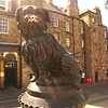 Greyfriars Bobby Memorial Statue on the sidewalk across the Bar