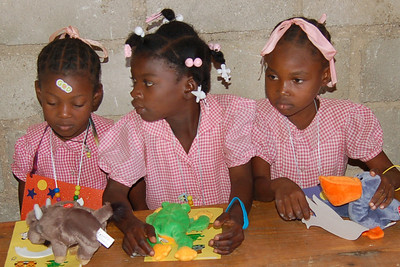 Kethia Lewis and other girls with their Beanie Babies at Bible School (love the God sticker on Kethia's head)