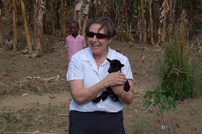 Linda Mitchell with a baby goat