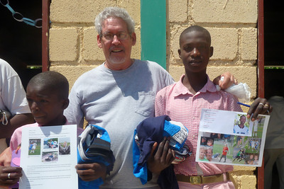 Ed with Rionaldino and Wilson - Ed took both boys soccer balls and sports clothes.  Rionaldino told Ed that next time he came to please bring him some athletic shoes :