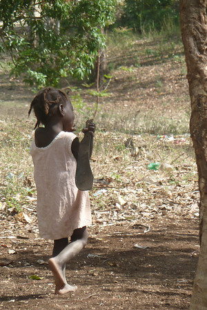 little girl with machete  - (I LOVE this picture)