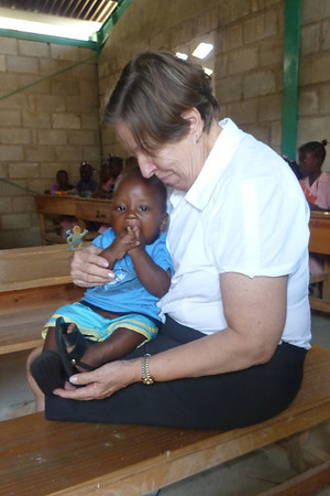 Linda Mitchell with Haitian child