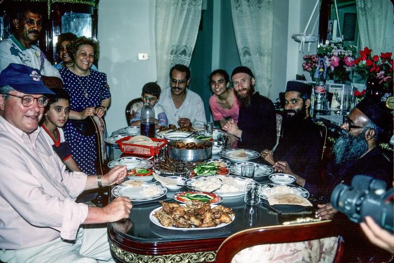 Photo of large meal in Alexandria, Egypt .  Pictured are Rich Diffenderfer (left), Father George's family and three Coptic Monks (right) - July 1997