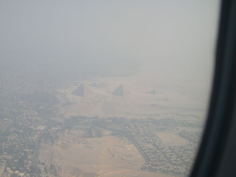 First view of the pyramids at Giza from the plane just before landing. The Cairo air is extremely hazy.