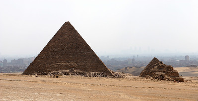 Giza Pyramids - Pyramid of Menkaure (left) and the Pyramid of Queens (right).  The city of Cairo is in the background.