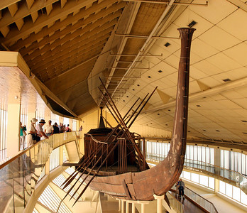 Giza Pyramids - One of Pharaoh Khufu's solar barques (boat) which is believed to have been used to bring the mummy of the dead Pharaoh across the Nile to the valley temple, where it was brought up the causeway into the tomb chamber.  The barques were then buried around the pyramid to provide transport for the pharoah in the next world.  This boat was unearthed in 1954 and reassembled from 1200 pieces of wood.