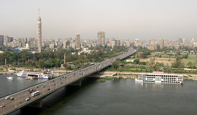 Cairo - View from my hotel room in the Ramses Hilton looking over the Nile river showing 6th October bridge and Cairo Tower.