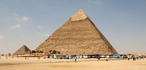 Giza Pyramids - Pyramid of Khafre (larger one on right), the smaller Pyramid of Menkaure (middle), and further to the left is one of the much smaller Queens Pyramids. In front of the Pyramid of Khafre are the remains of Khafre's Funerary Temple.
