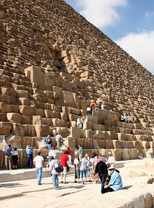 Giza Pyramids - Entrances to the Great Pyramid of Khufu.  The upper entrance is original entrance, while the lower entrance (by person in orange shirt) is the entrance blasted into the pyramid by early explorers and now used by tourists (including me!) to enter the pyramid.