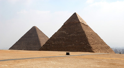 Giza Pyramids - Great Pyramid of Khufu (left) and Pyramid of Khafre (right).  The city of Cairo is in the background.
