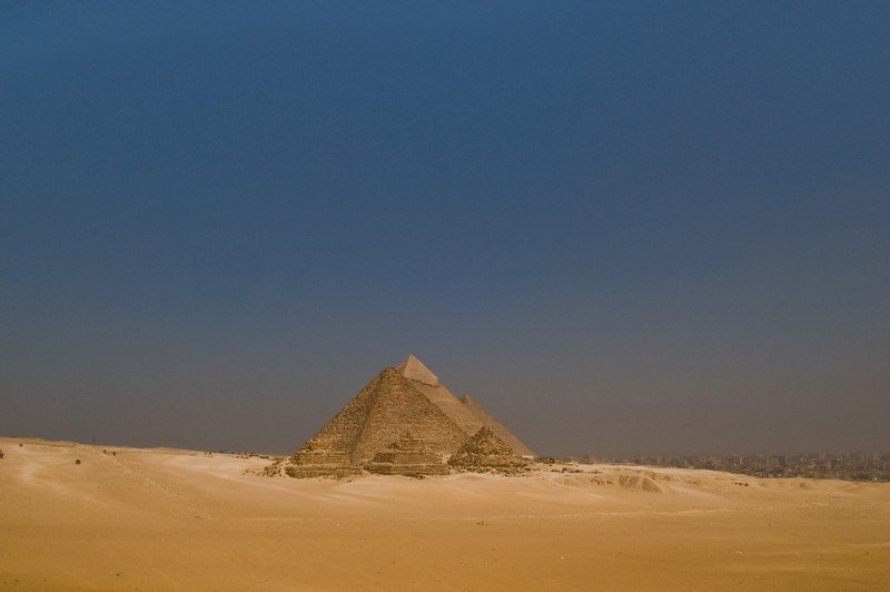 Title: Pyramids and Cairo<br /> Date: October 2009<br /> The Great Pyramids of Giza with Cairo to the right.  I actually walked around one (the one with the smooth top)!