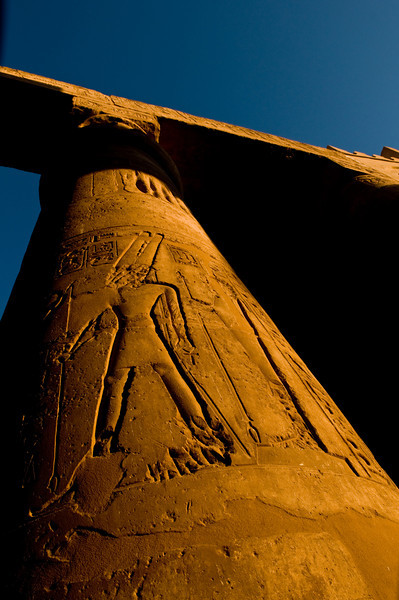 Title: Walk Like An Egyptian<br /> Date: October 2009<br /> A column, with Ancient Egyptian carvings, at Luxor Temple.  The shot is at sunset.