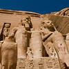 Title: At the Feet of Pharoh<br /> Date: October 2009<br /> Two of the colossal statues of Ramses the Great at Abu Simbel.