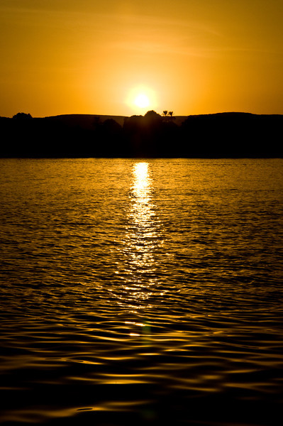 Title: Two Constants<br /> Date: October 2009<br /> The two constants of Egypt: the sun and the Nile. Aswan.