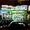 Title: Fruit Stand at Night<br /> Date: October 2009<br /> Driving through the streets of Cairo, heading to the train station for our overnight trip to Aswan.