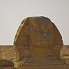 Title: Head of the Sphinx<br /> Date: October 2009<br /> The Great Sphinx at Giza, with a Bedouin camel rider in the background.
