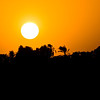 Title: Ra Sleeps<br /> Date: October 2009<br /> The sun setting over the Nile at Kom Ombo.