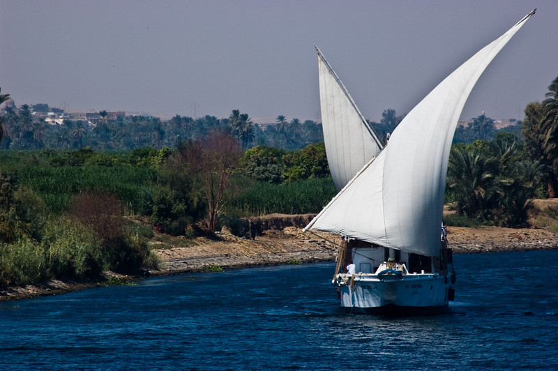 Title: Sail the Nile In Comfort<br /> Date: October 2009<br /> While our cruise ship wondered down the Nile, we saw many sailing ships cruise by.