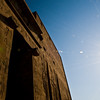 Title: Sun Over Edfu<br /> Date: October 2009<br /> The huge pylon gates at the Temple to Horus at Edfu.