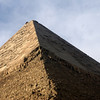 The pyramids were covered in alabaster.  Muhammad Ali had it removed for his cathedral.