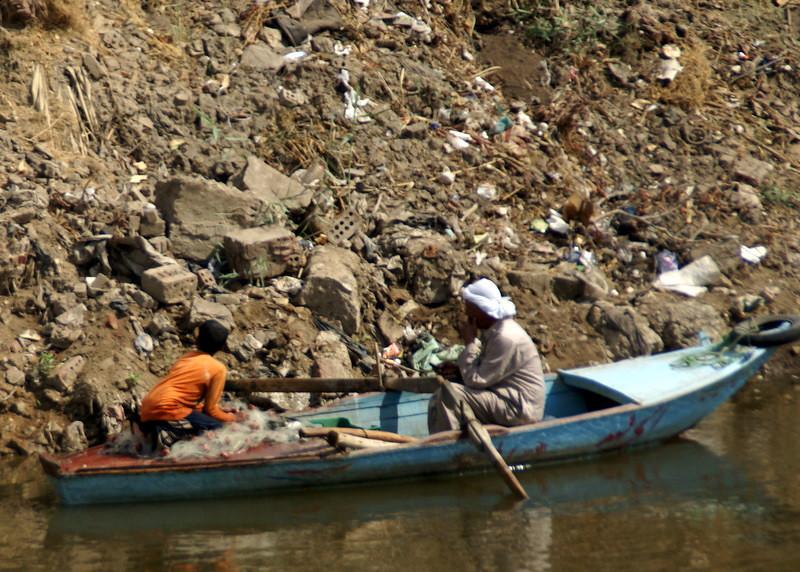Fishing along an irrigation canal