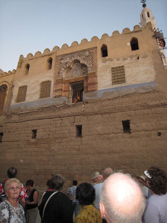 Looking up at a building perched on what was street level prior to the excavation of Luxor temple.