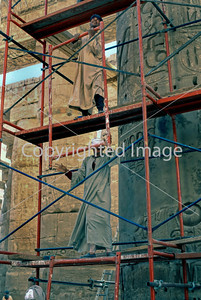Karnak, Egypt, Egyptian Construction Workers In Traditional Dress Setting Up Scaffolding for Renovating Temple